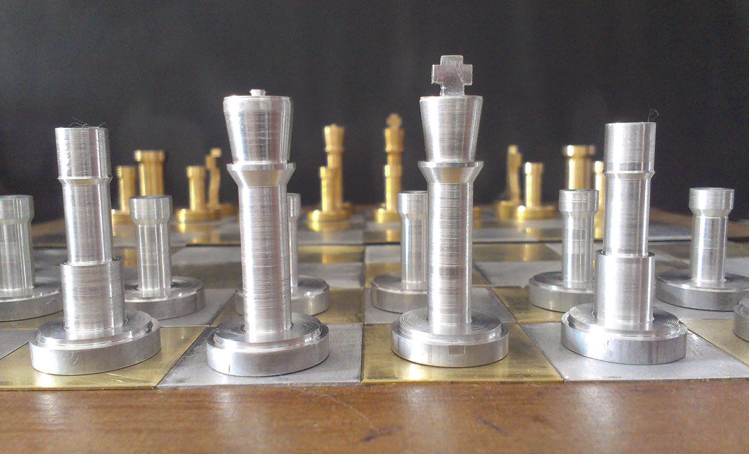 Chess set with brass and aluminum pieces Analog Games