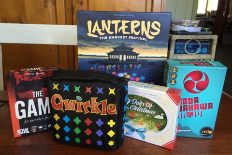 ' ' from the web at 'http://www.analoggames.com/wp-content/uploads/2016/07/vacation_games_transporting_portable_board_games_analog_games_01-480x320.jpg'
