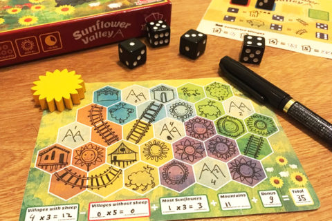 ' ' from the web at 'http://www.analoggames.com/wp-content/uploads/2017/08/sunflower_valley_roll-and-draw_dice_game_pen-and-paper_tabletop_board_game_gameplay_03-480x320.jpg'